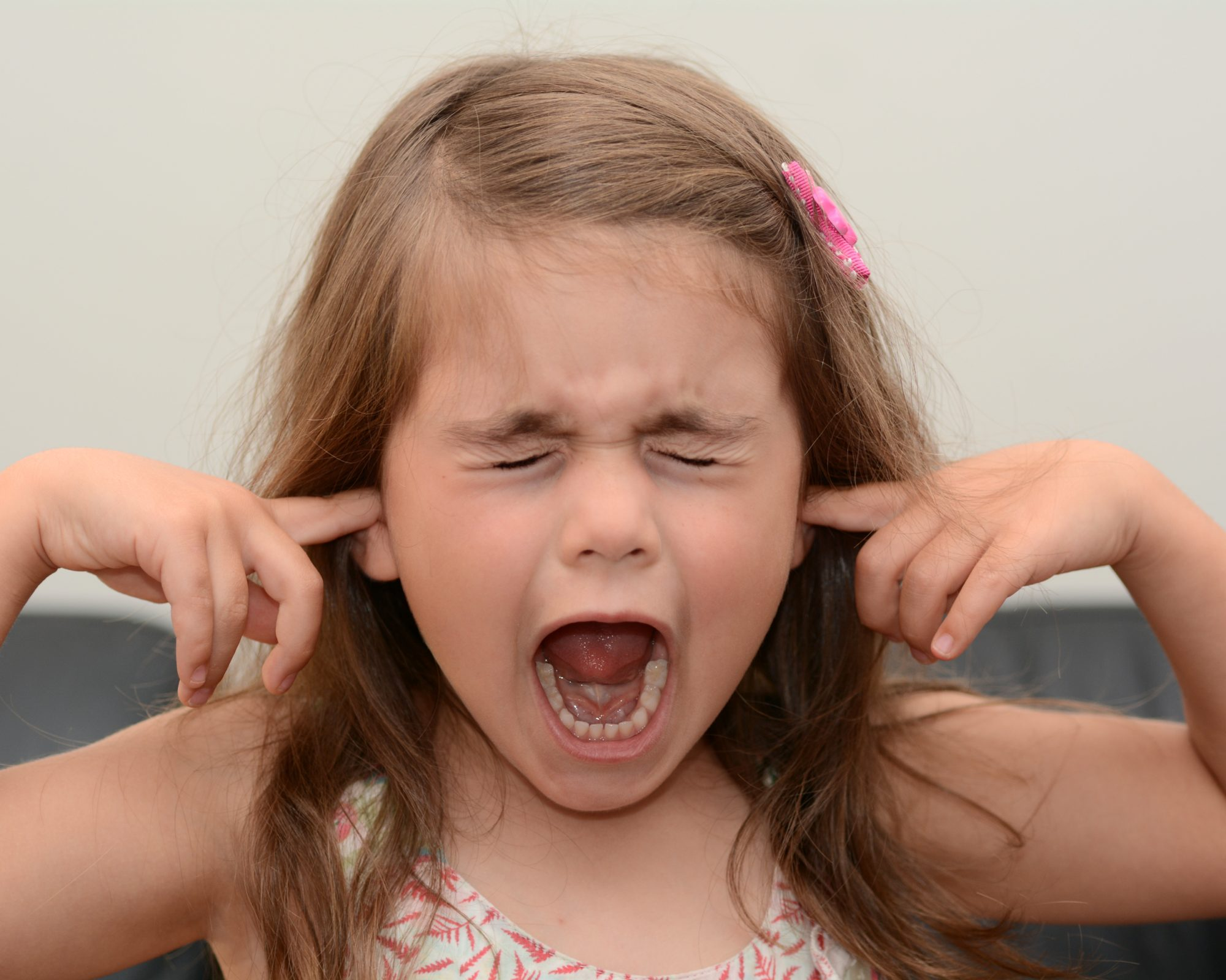Screaming child (girl age 05) face. concept photo of stress and anxiety.